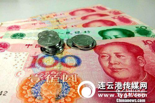 资料图:人民币。_#5#_记者 李金磊 摄